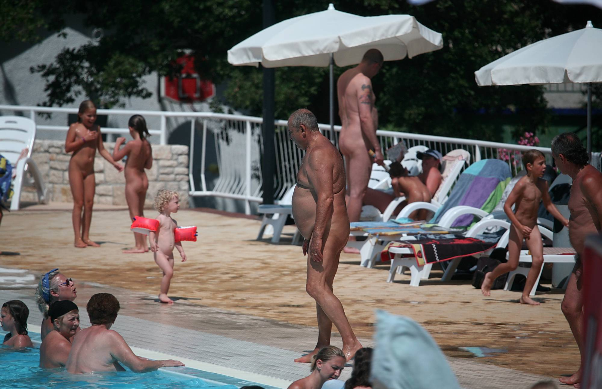 Nudist Pics Liesurely Pool Strolling - 2