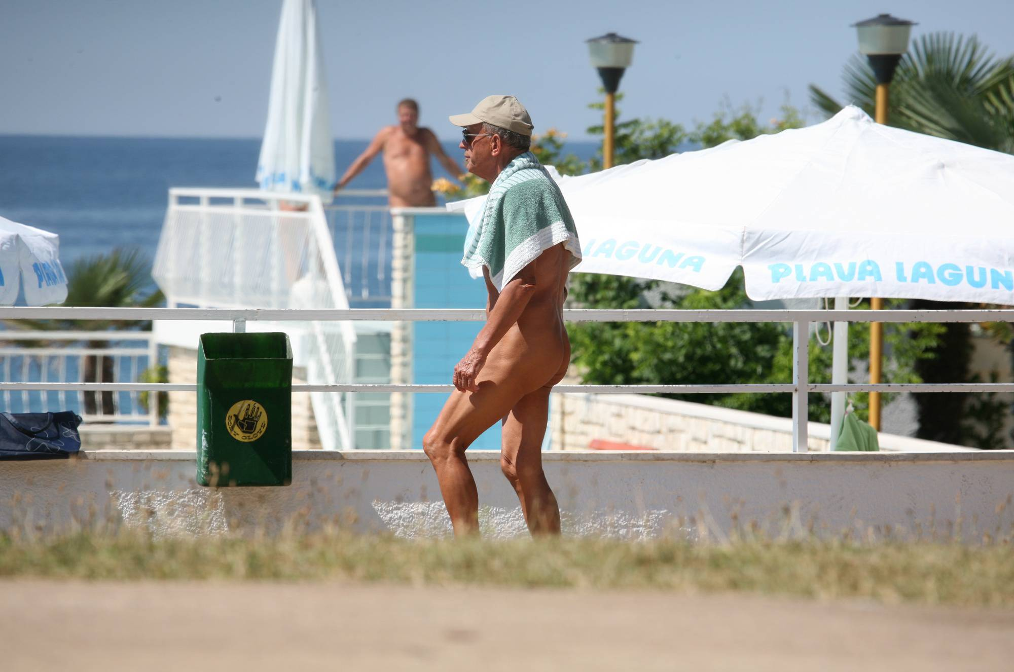 Nudist Photos Nuda Pool Visitor Walk-By - 2