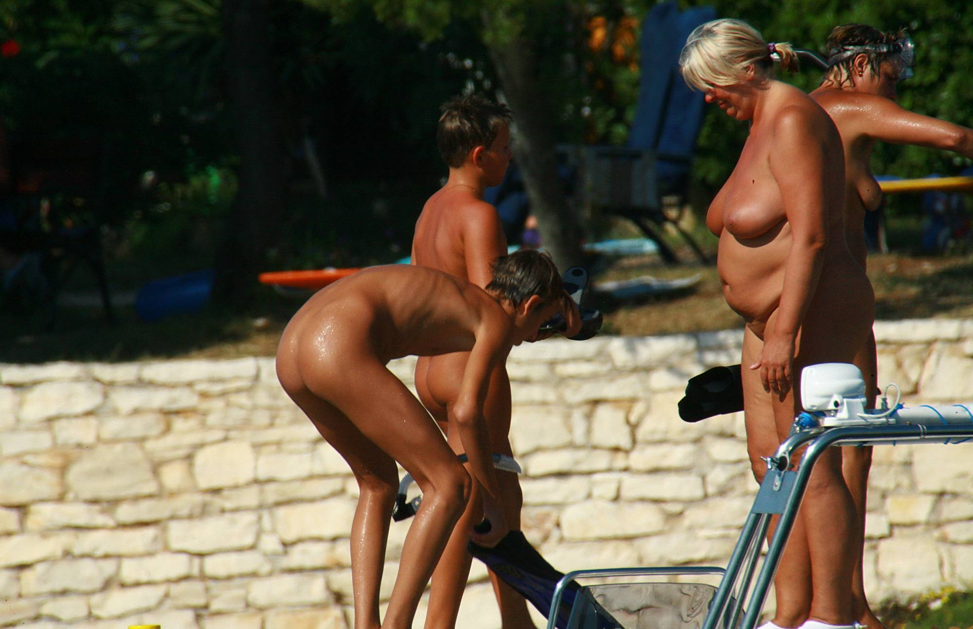 Nudist Pics Lounging By The Grass - 2