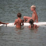 Several Kids On Surfboard