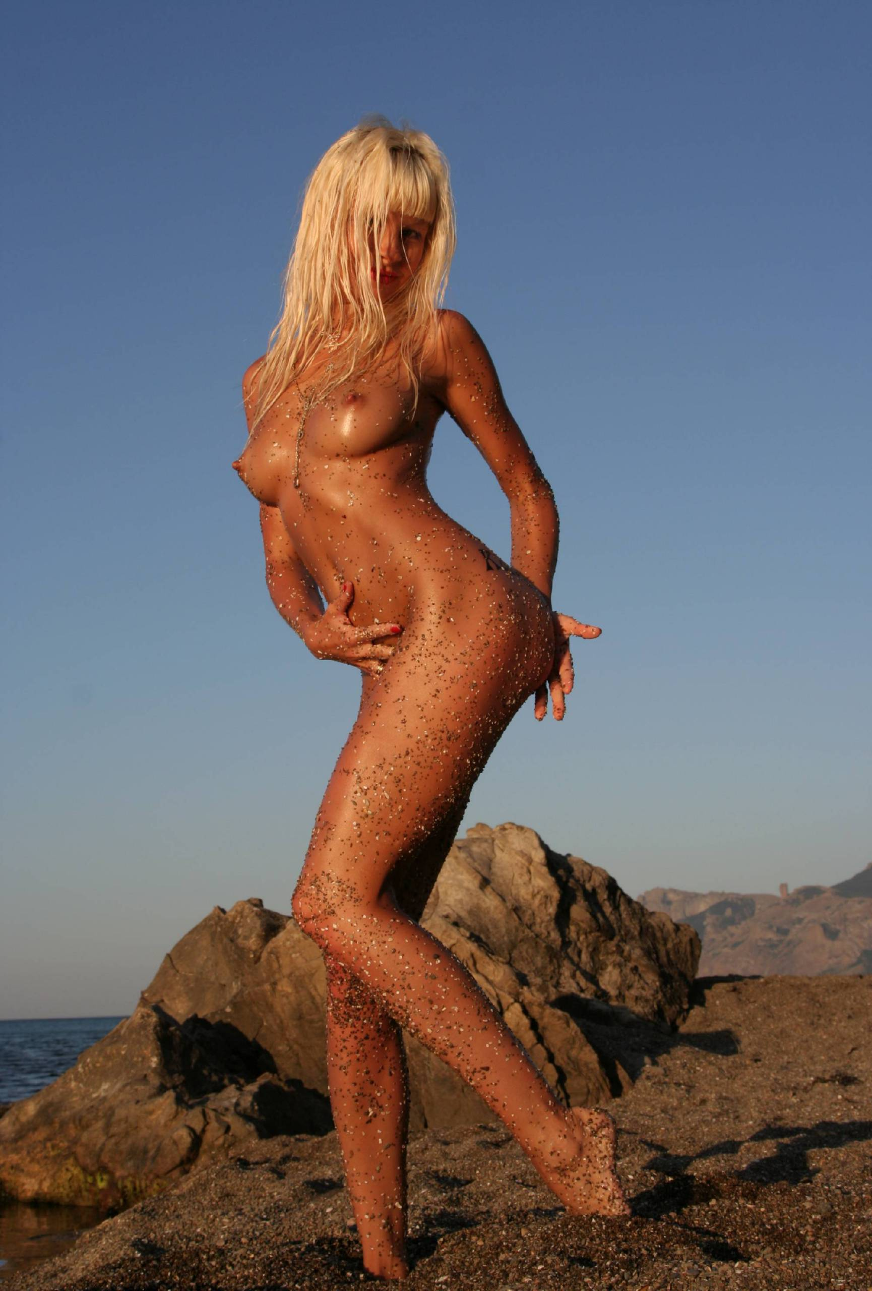 Nudist Pictures Nudist Sunblaze on Rocks - 1