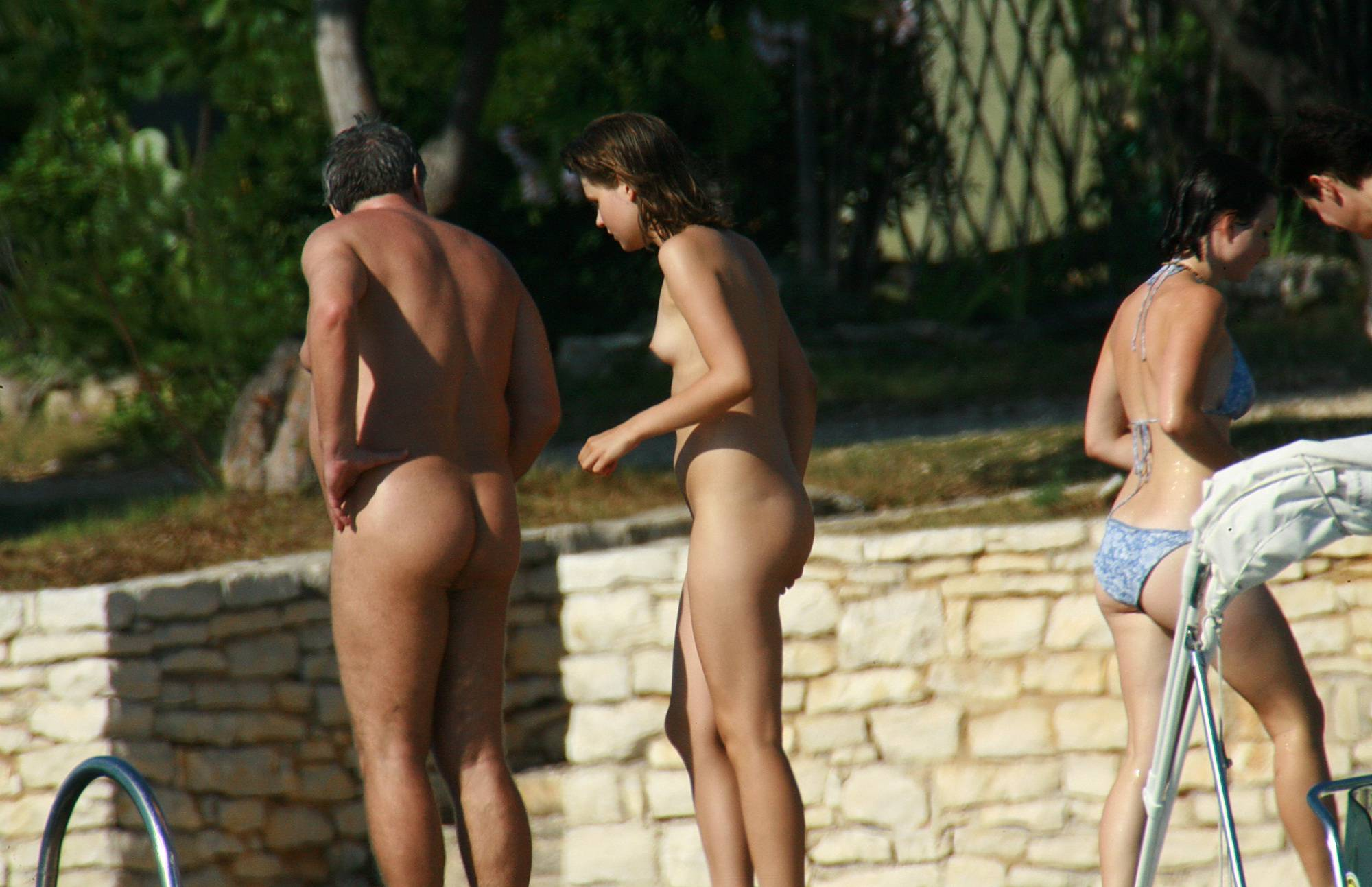 Nudist Pictures Strolling On The Veranda - 1